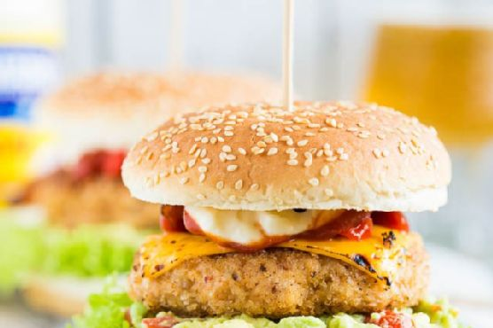 Chicken burger with guacamole and chipotle